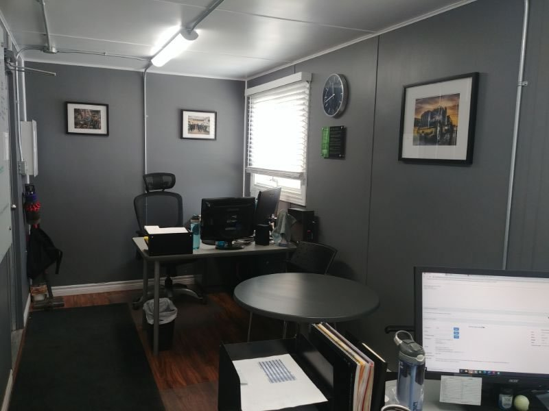 windowed storage container setup as an office with 2 desks