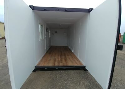 Inside view of a Jobsite container with insulated walls and beautiful flooring.