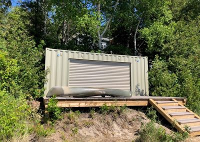 beach storage container on waterfront with steps