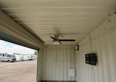 bunkie showing ceiling fan with garage door open